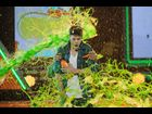 Will Smith holds Justin Bieber as he gets hit by slime at the Kids' Choice Awards 2012
