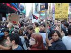 Demonstrators rally in support at the Occupation Party at Times Square
