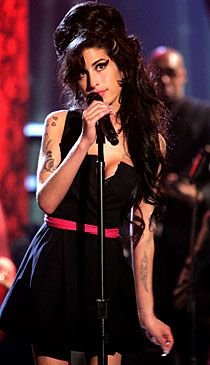 "Badass Brit bombshell Amy Winehouse performs her hit song, ""Rehab."""