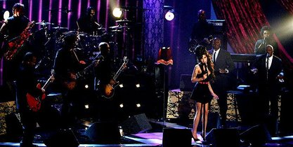 Amy Winehouse brings along the big band for maximum booty-shakability.